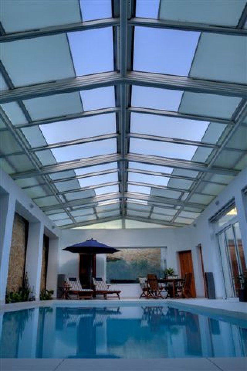 This Retractable Roofing System Over A Private Residential Pool Is A Double Pitch Featuring 2 1 Indoor Pool Design Indoor Swimming Pool Design Pool House Plans