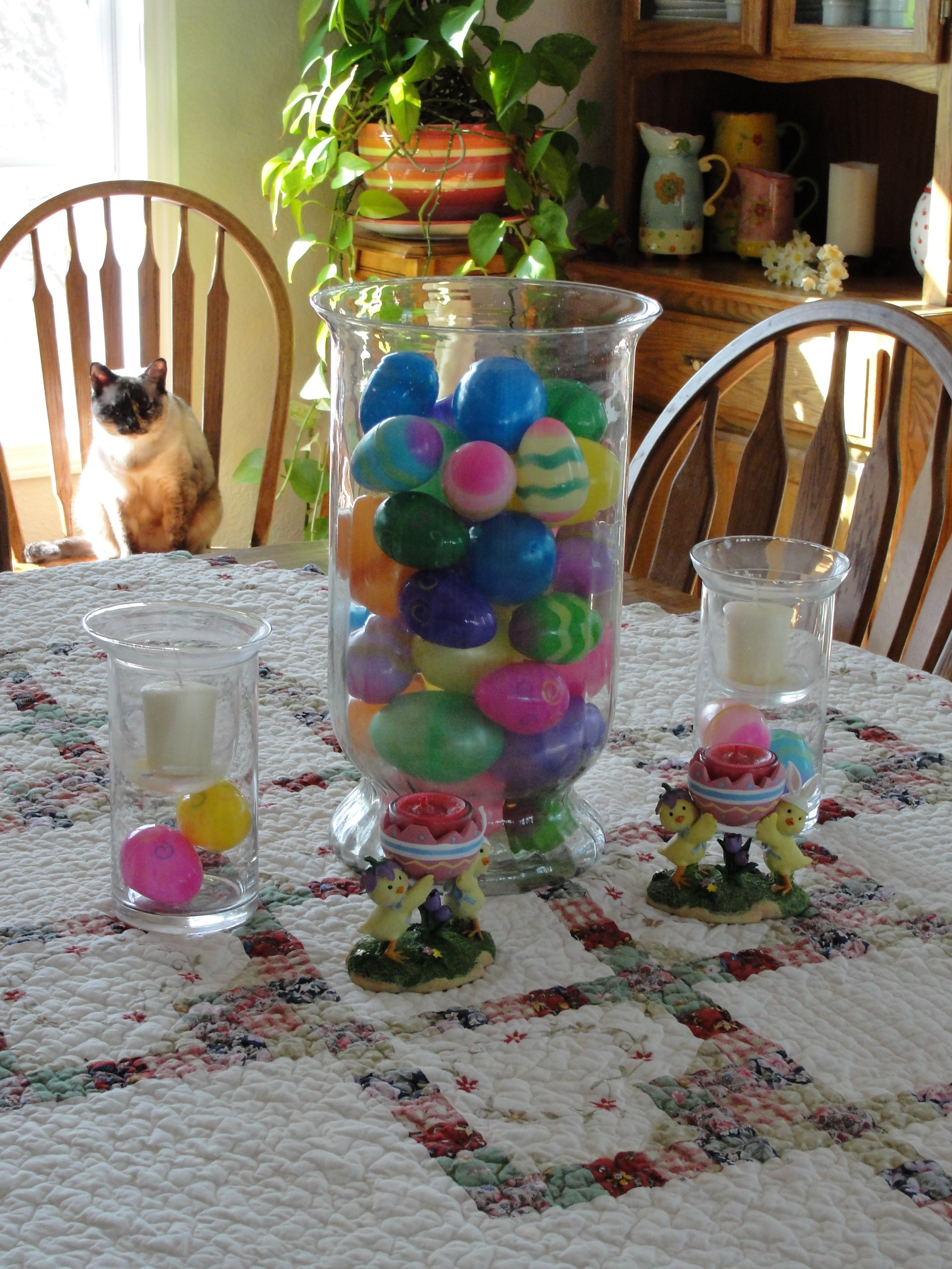This is an Easter decoration I made. Easter eggs in a big vase and candle holders.