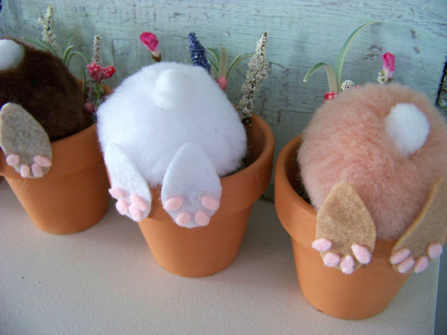 curious little bunny pots whimsical decoration bunny in flower pot bunny butt easter. Black Bedroom Furniture Sets. Home Design Ideas