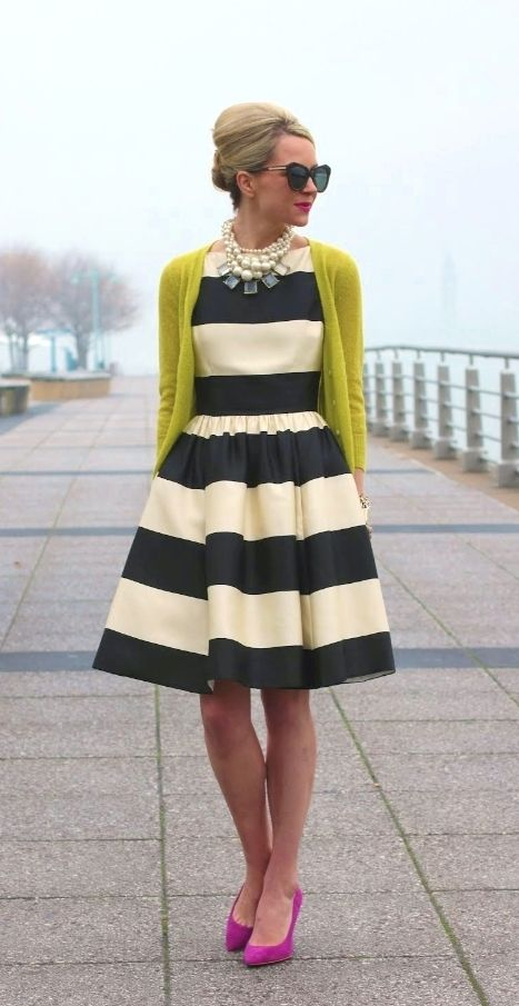 -horizontal line -horizontal lines found on the whole dress. -decorative lines because the stripes are printed into the dress. -the horizontal lines reinforce width, bulk, and shortness. -a relaxed but slightly formal look is conveyed with these lines.