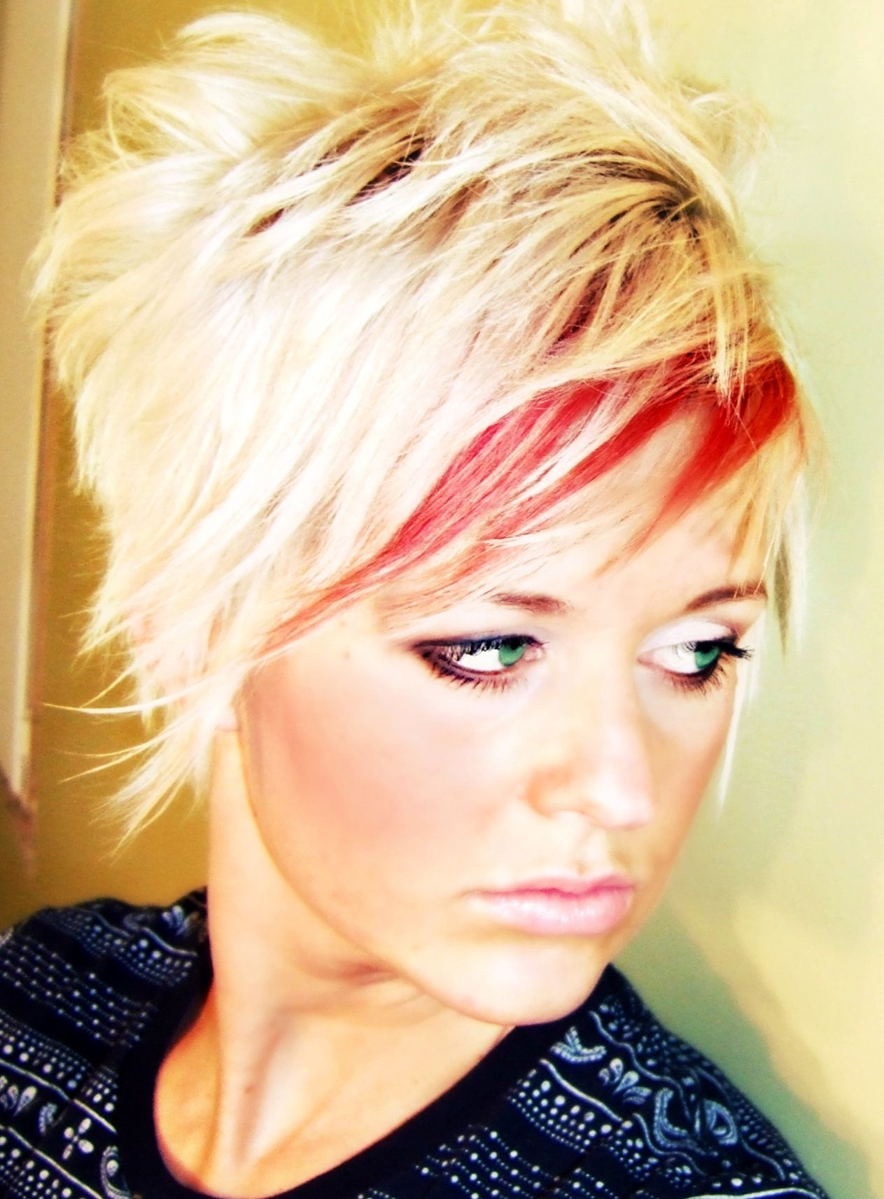 Crazy shaggy cut platinum blonde with red highlight at the bang for