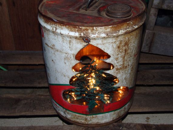 This listing is for an antique oil/gas can that has been repurposed into a creative Christmas decoration! It is lit with standard string lights