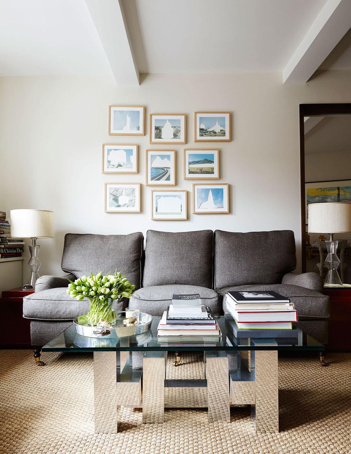 a living room vignette with quirky art and vintage chrome coffee ...