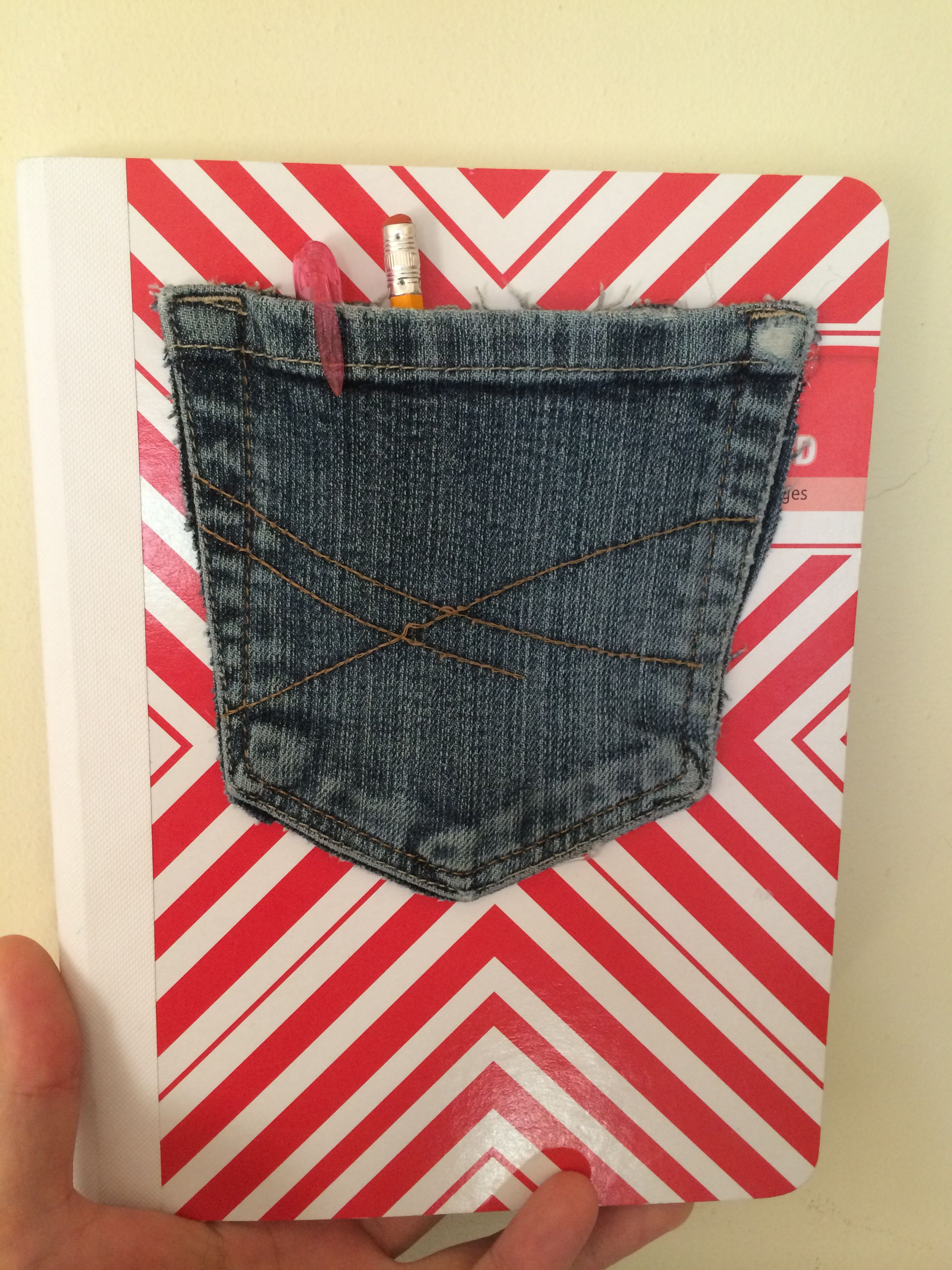Notepad cover pocket!! Just cut out of old jeans and hot glue to notepad!!! Done :)