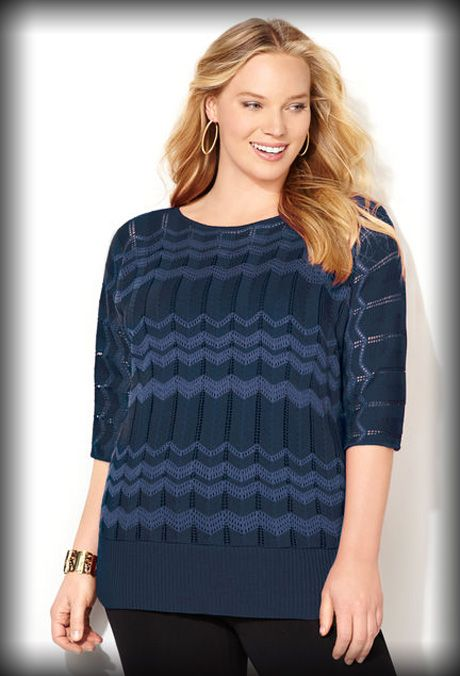 Chevron Stitch Pullover Sweater • Knit, elbow length pullover sweater.  • Dolman sleeves. • Miter stripes with shimmering, glitter fabric. • Wide, ribbed trim band at the hem. • Acrylic. Machine wash. Made in USA.  • Approx. 28 inches long.
