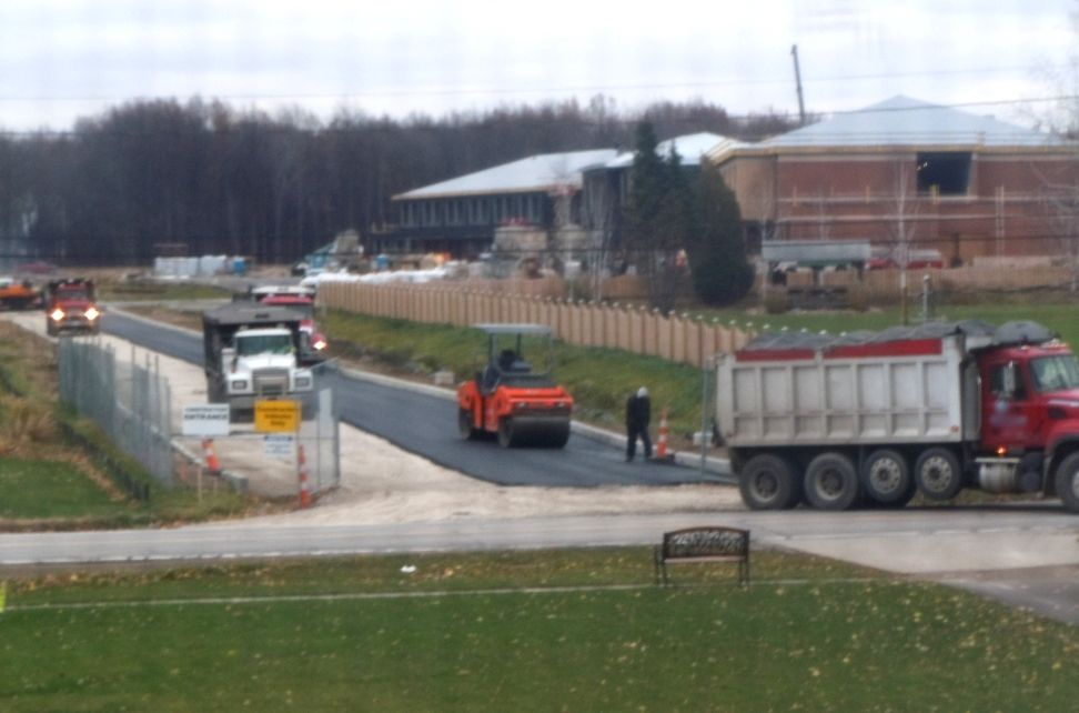 Main drive being installed at new middle school in Avon