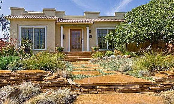 Drought Tolerant Yard A Low Retaining Wall Of Stacked Flagstone Has The Effect Setting This San Go House And Garden On Pedestal
