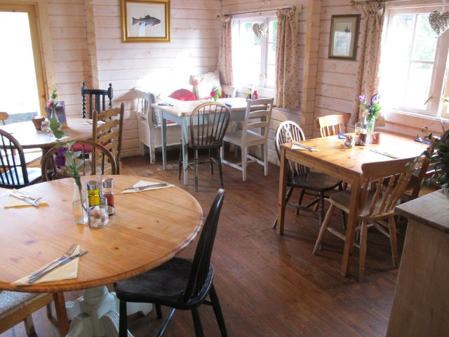 Cafe interior at Sumners Ponds Fishery & Campsite in West Sussex - click through to read our review & blog about this campsite & camping in West Sussex