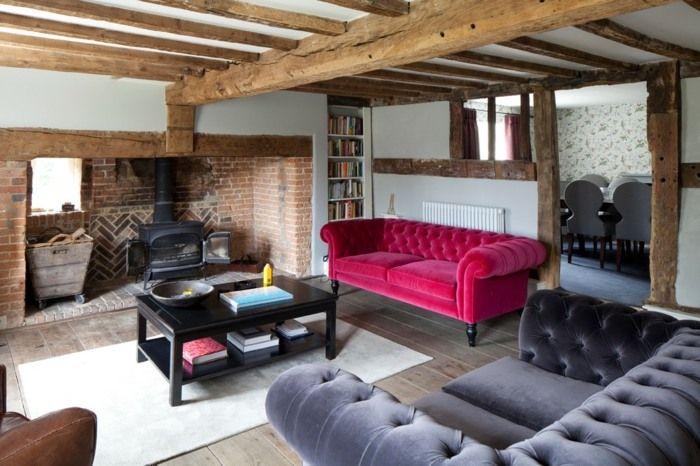 wohnzimmer mit holzbalken und eklektischer einrichtung | landhaus