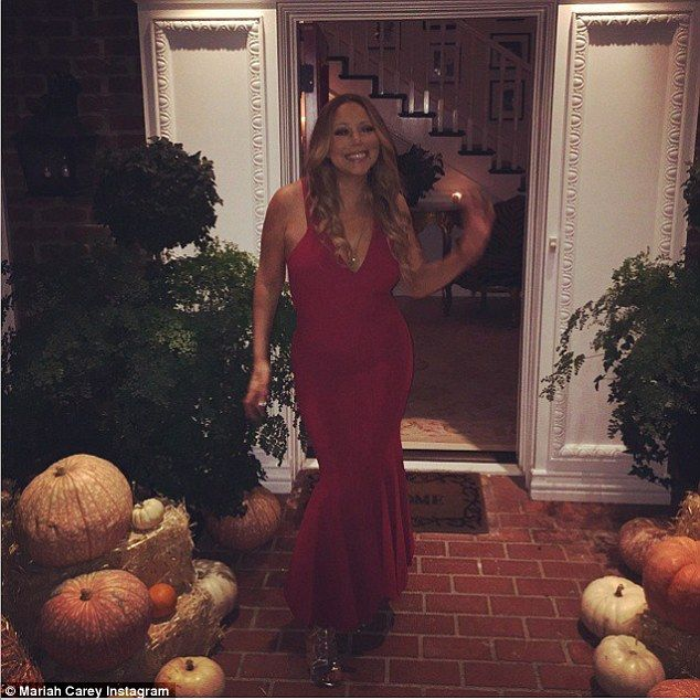 What this old thing? Mariah Carey marked the day in a figure hugging floor length gown