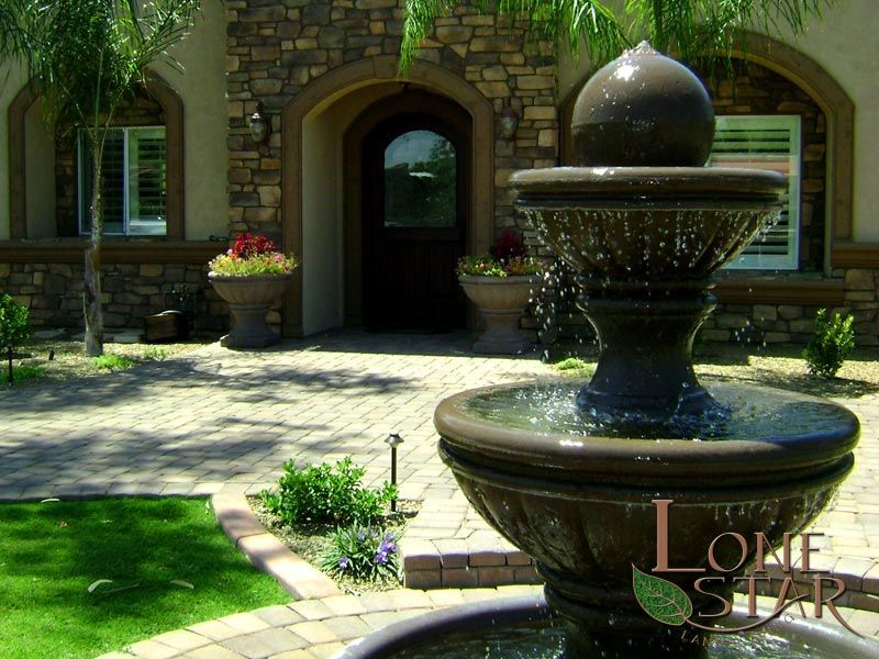 This landscape design features a paver driveway and water feature fountain in Scottsdale, AZ. - www.lonestaraz.com