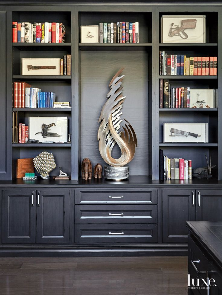 Built in black stained bookcases with storage by Ru0026G
