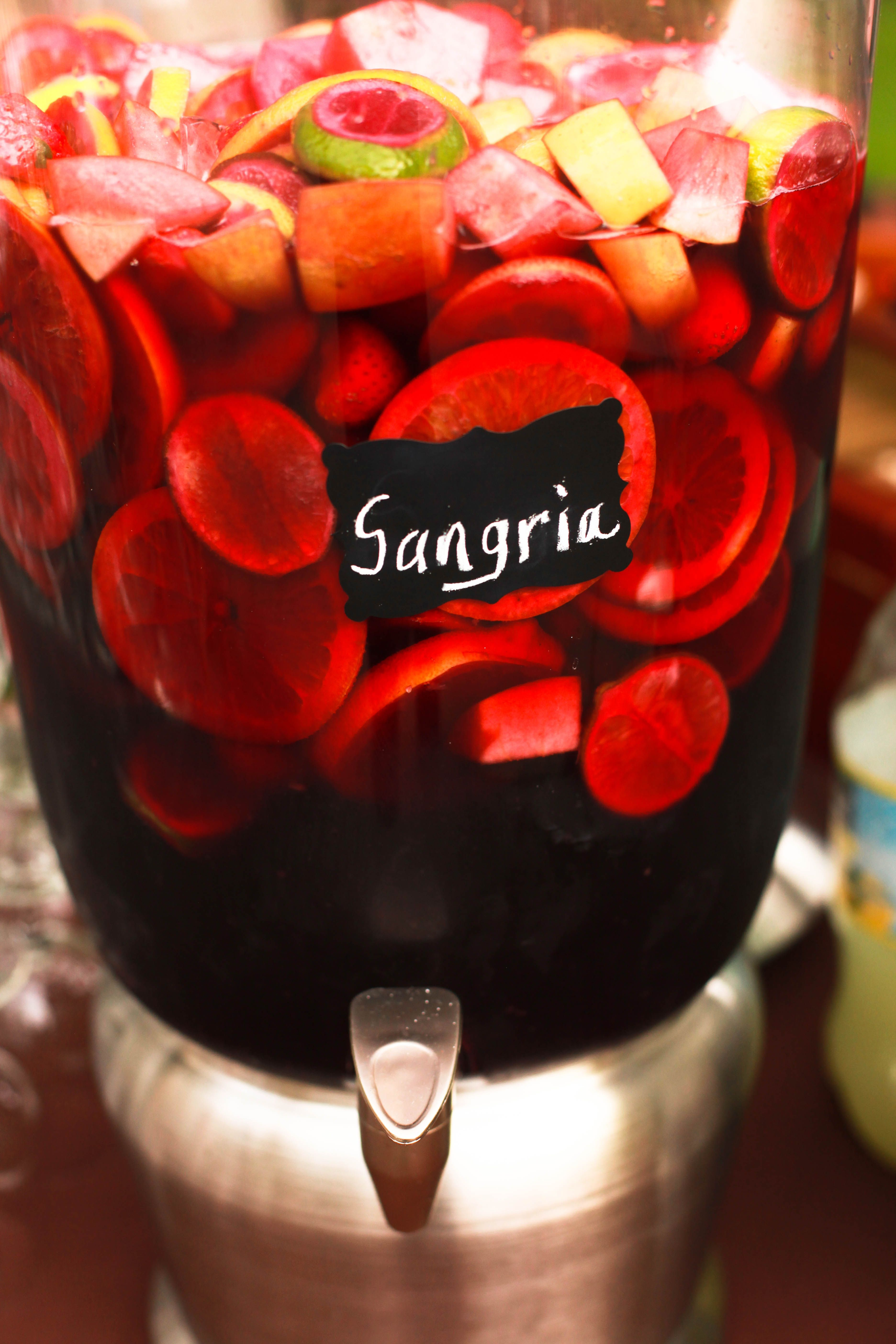 Sangria...refreshing and a simple way to give refreshments to a big crowd...Pour you own.