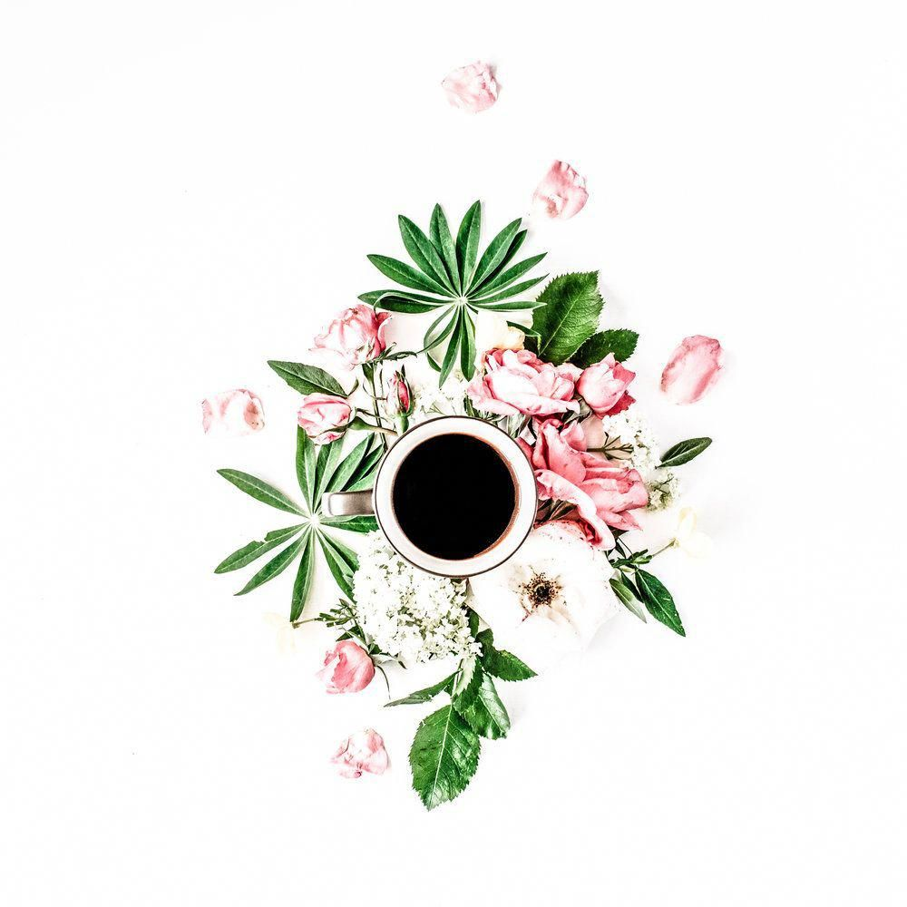Black coffee mug pink roses and white hydrangea flowers bouquet on