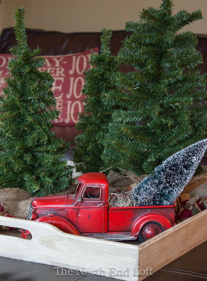 red farm truck with christmas tree | the north end loft