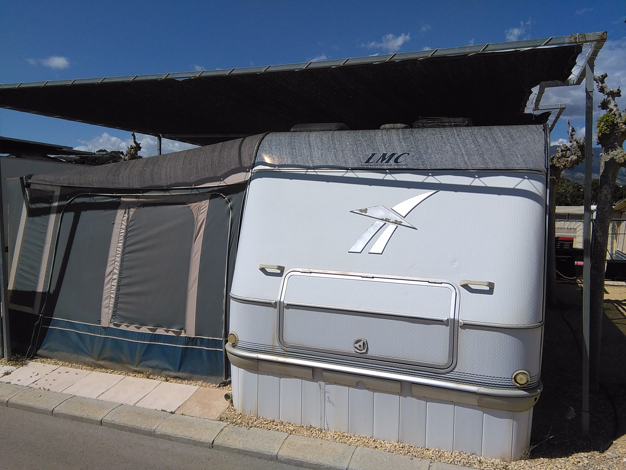 LMC Caravan For Sale On Camping Villamar Benidorm Large With Inaca Awning Toldo Shade Situated A Quiet Fenced Plot Paved Patio
