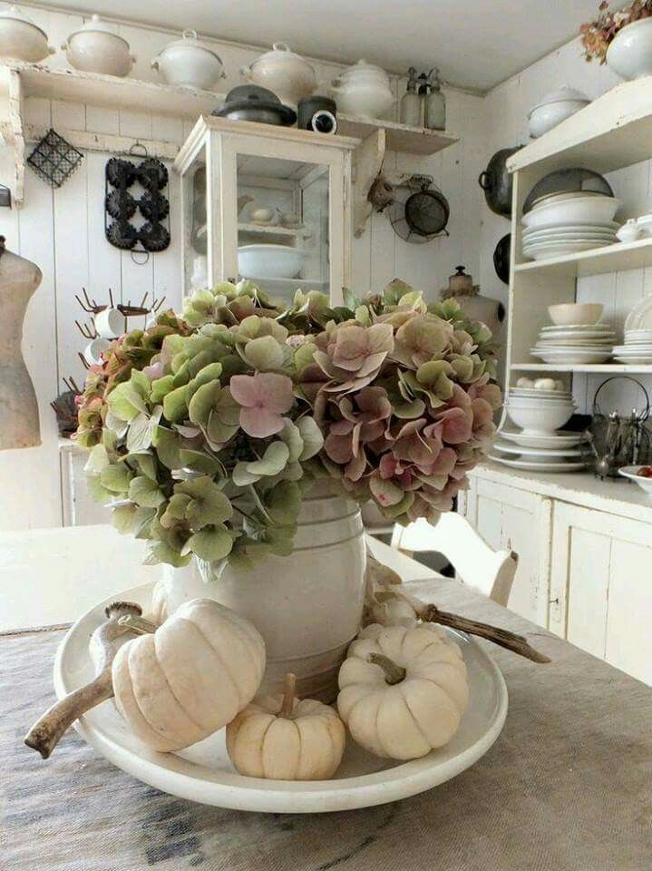 Shabby, vintage, farmhouse kitchen with sweet fall decor. Love the hydrangea with the white pumpkins. #farmhousedecor