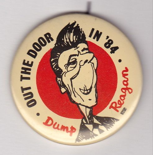 ANTI REAGAN POLITICAL BUTTON - OUT THE DOOR IN 1984