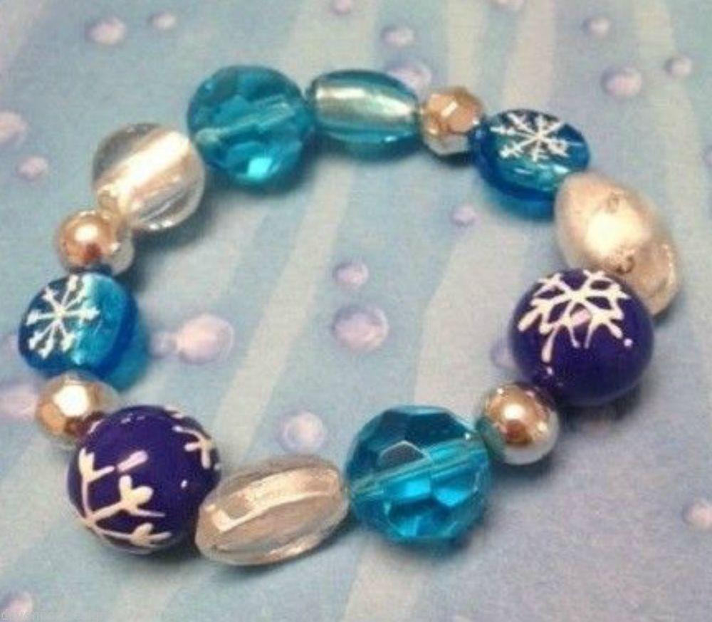 Snowflakes Bracelet Stretch Handmade Glass Blue Clear White Winter Ski Skate #DavenportDesigns #Stretch