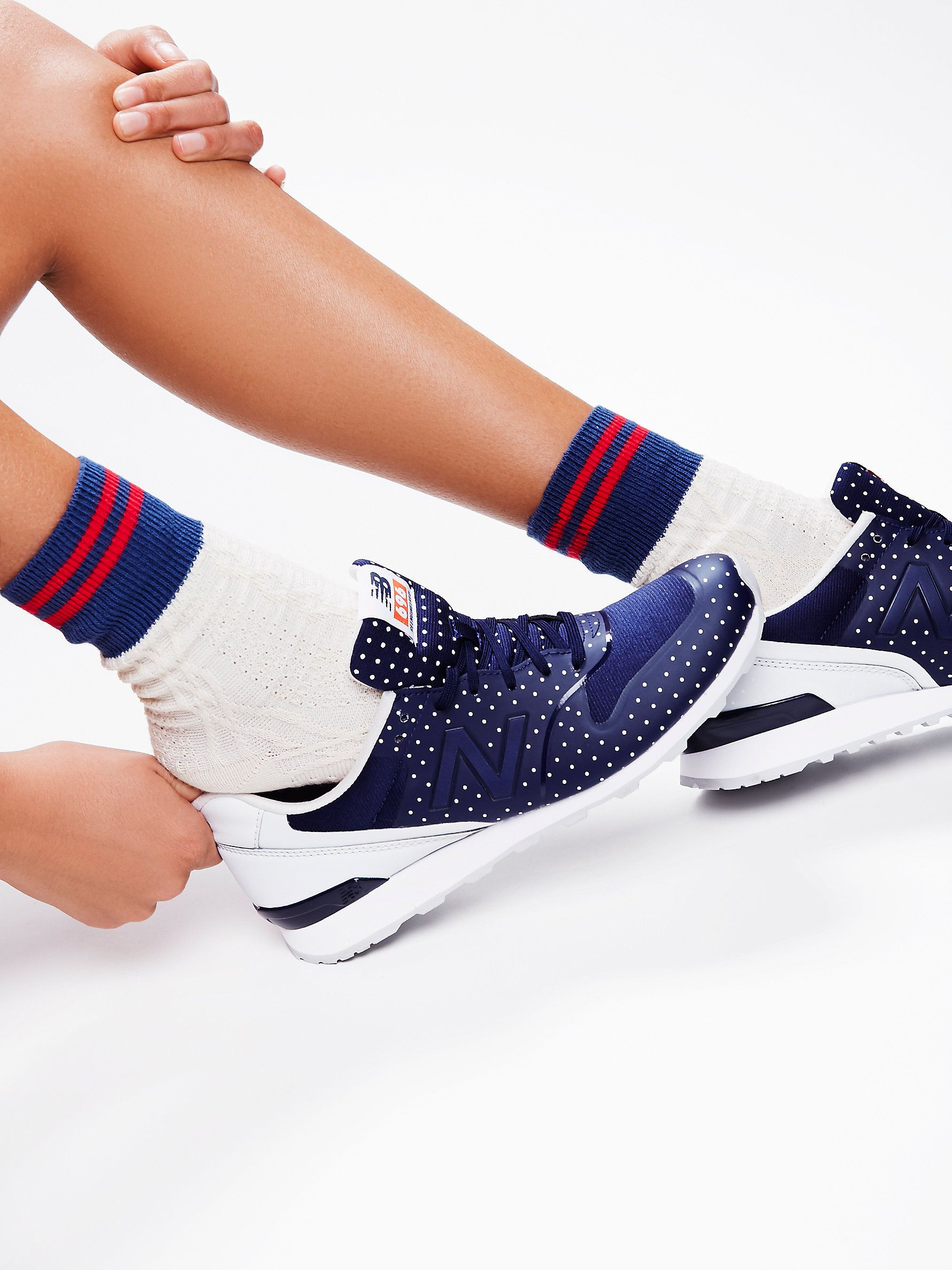 696 Re-Engineered Polka Dot Trainer   New Balance's classic style is reinvented with this lightweight, breathable trainer. Features a cute femme polka dot print.  Cushioned footbed for ultimate support.