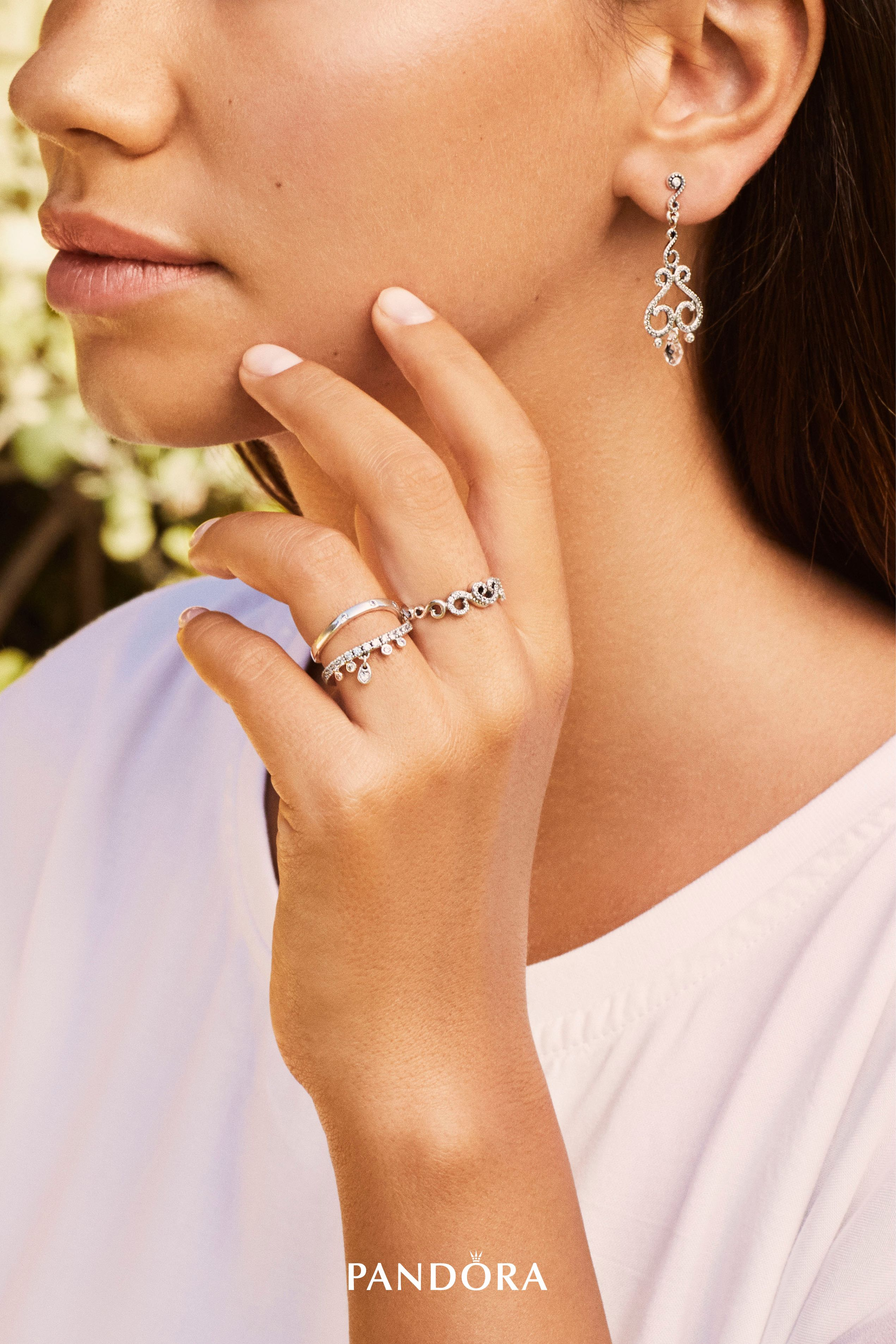61e22c1eeab9e Discover lovely new looks with organic swirl forms and briolette droplets.  Combine the sterling silver chandelier earrings and ring with a curved ring  to ...