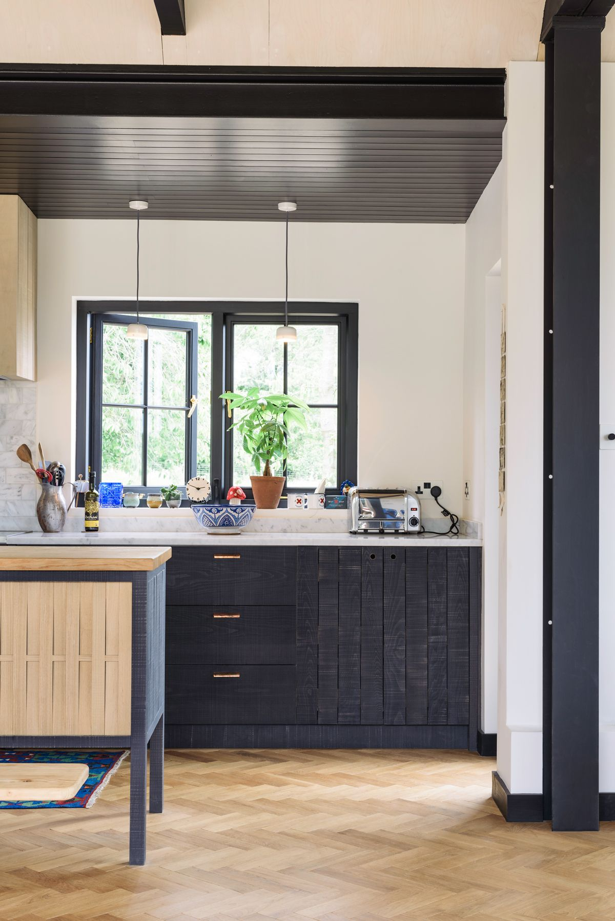 parquet floor and deep blue cupboards make the perfect combination ...