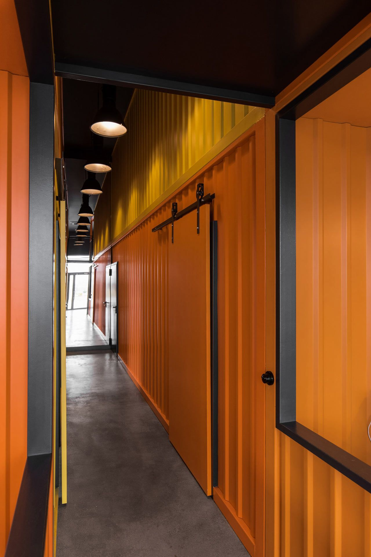 An Office in Poland Inspired by Shipping Containers by mode:lina - Design Milk