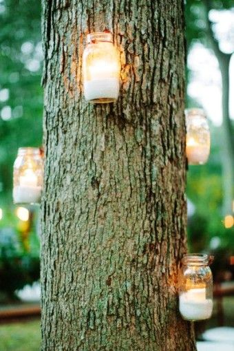 diy outdoor hanging mason jar candle lights in tree trunk