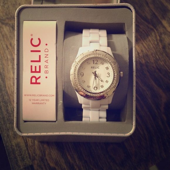 White Relic Watch This Watch Is So Fashion Forward And Only Been Worn Once.  There Are Extra Links For Those Who Need Them And Comes With Original Box.