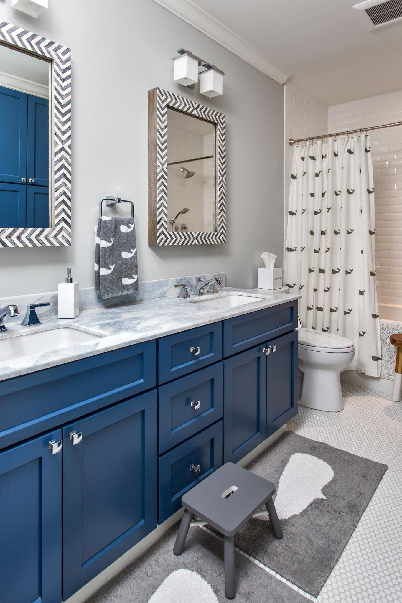 Coastal bathroom with gray, white, and navy cabinets, whales, and ...