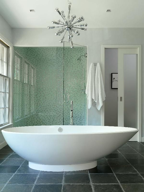 shower walls are made of glass and metal circles (frosted white ...