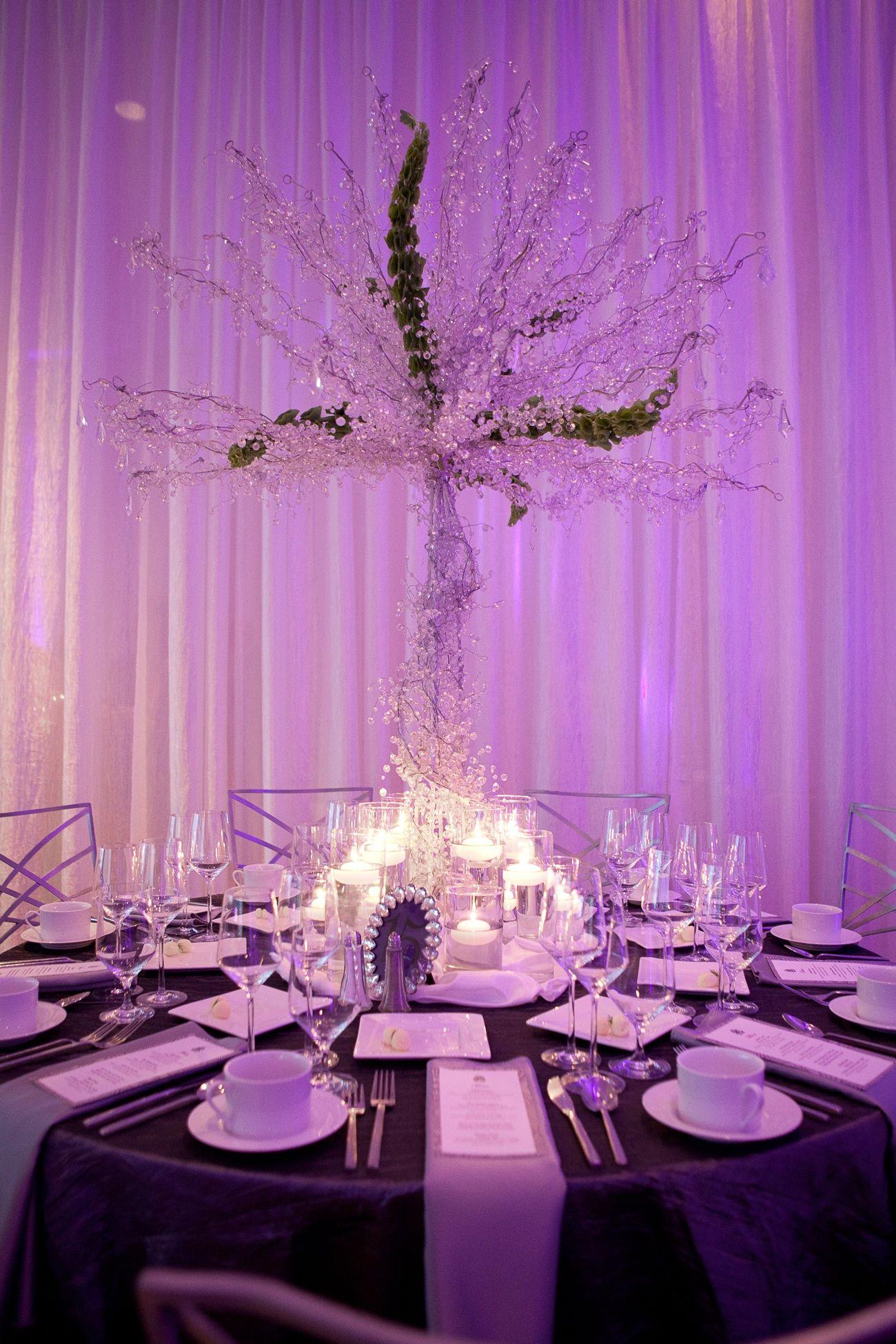 glamourous wedding reception table high non floral centerpiece