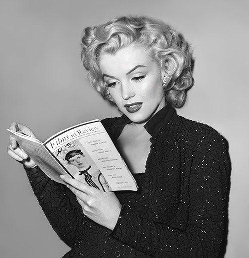 Marilyn Monroe reading a magazine on the set of 'Gentlemen Prefer Blondes', 1953.