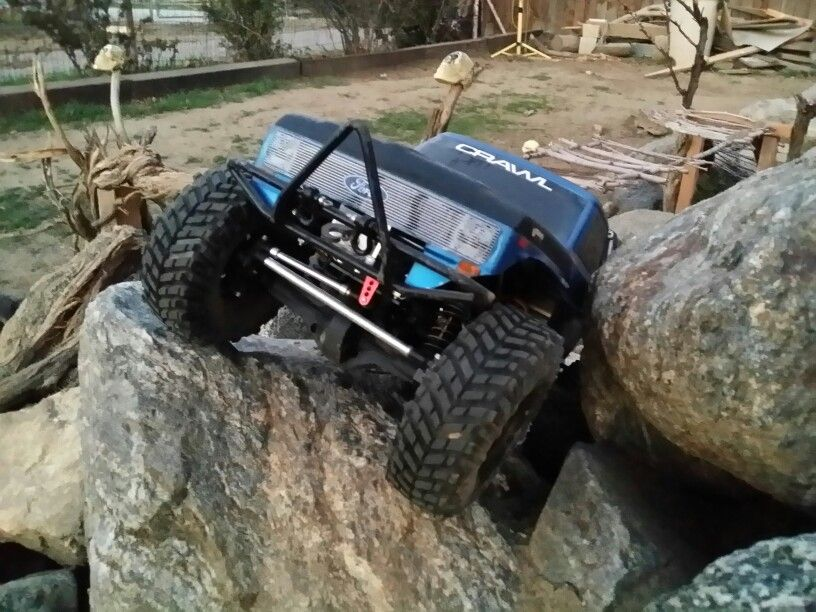 Axial Scx10. 2-speed tranny with Level3-RC dual motor mount and dual Holmes Crawlmaster 20t motors , BR-XL esc, and waterproof. Poking out from under the grill is a 220oz. KMS Servo Winch.