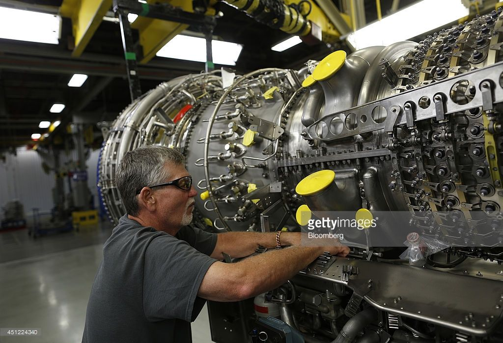 production assembly mechanic howard shanor works to hang a gearbox on a cf6 80c2 jet turbine engine mechanic