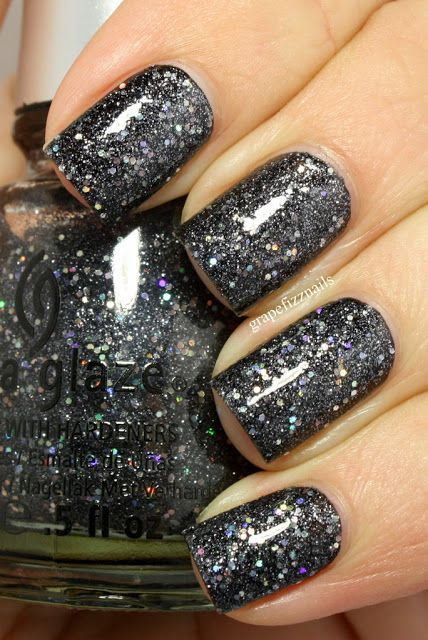 glitter mani (by Grape Fizz Nails) using China Glaze's Some Like It Haute.  Loads of silver micro glitter and larger holo glitters give this a gunmetal look.  She layered two coats of a black creme.