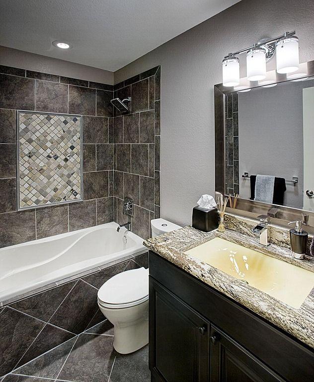 Dark Tiling And Granite Counter Tops Create A Modern Elegance In