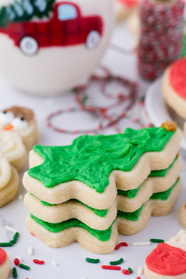 Cut out sugar cookies are perfect for the holidays! This recipe has ALL the options - a no chill option, a gluten free option, plus buttercream and royal icing recipes! The recipe is easy to follow with step by step pictures and a video tutorial! #cutoutsugarcookies #cutoutcookies #christmassugarcookies