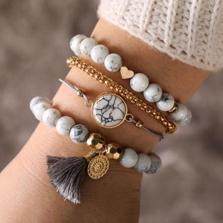 Features gold and marble elements. 4 Bracelets Per Set High-Quality Zinc Alloy