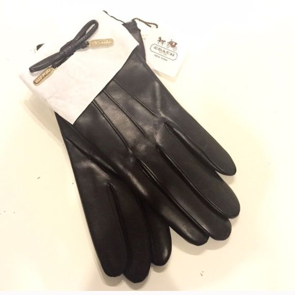 Coach leather and cashmere gloves Black leather gloves with super soft and warm cashmere lining. Finished with little black leather bows and gold coach logo. Brand new, never worn! Size 6.5 (Which is a small in my opinion). Coach Accessories Gloves & Mittens