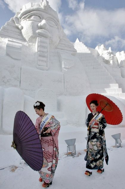 In front of ice carving of Egyptian temple....Japan?
