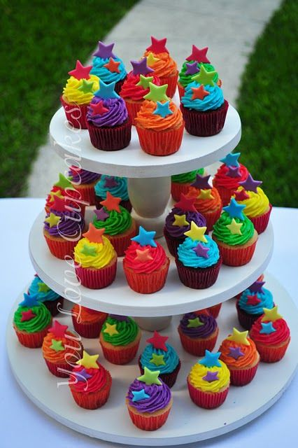 Wow !! Gorgeous rainbow cupcake Tower.