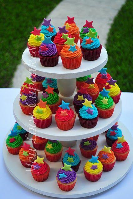 Wow !! Gorgeous rainbow cupcake Tower.
