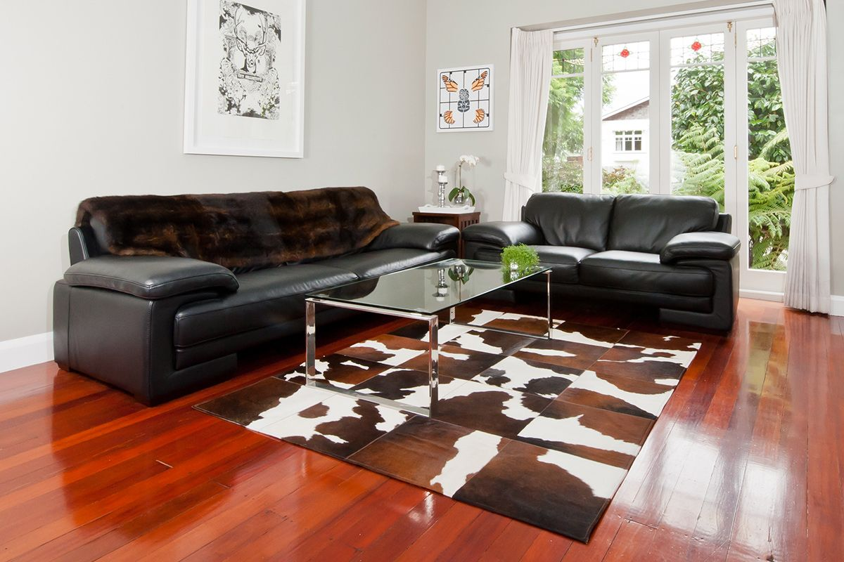 Embellish Your Home With Awesome Cowhide Rugs Astonishing Stitched Cowhide Rug With Black Leather Sofa Glass Top Coffee Tablecoffee
