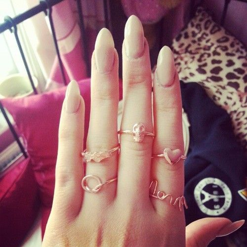 nuckle rings and pointed nails