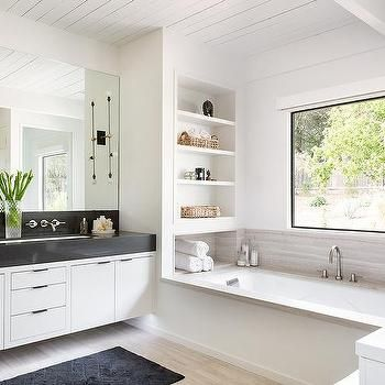 built in shelves over drop in bathtub | via orilla bathrooms in 2019