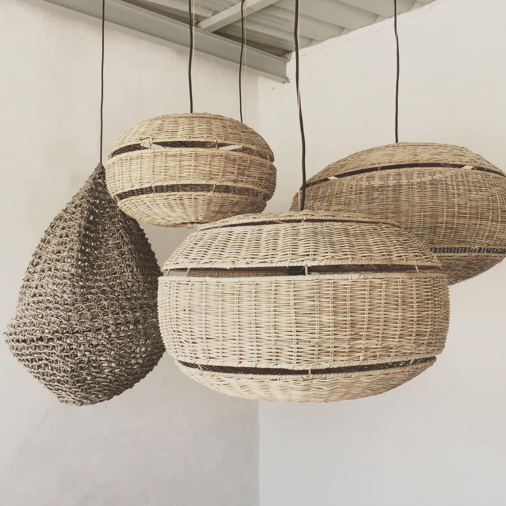 Welcoming White Kitchen Is Illuminated By Regina Andrew: Rattan Hanging Lamps