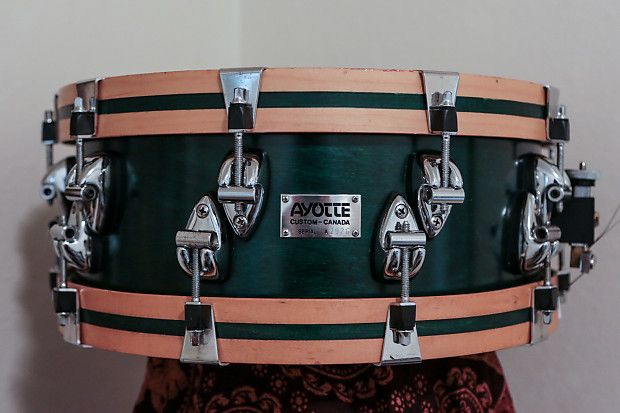 """Roy Ayotte 14 x 5.5"""" wood hoop snare drum with 9 ply shell, first generation Ayotte snare strainer; finished in Jade Green Satin."""