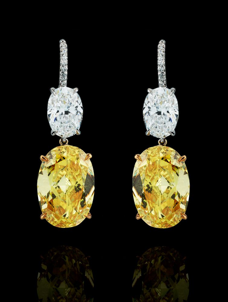 Stunning Fancy Yellow And D Internally Flawless Diamond Earrings Totaling 14 32 Carats Handcrafted In