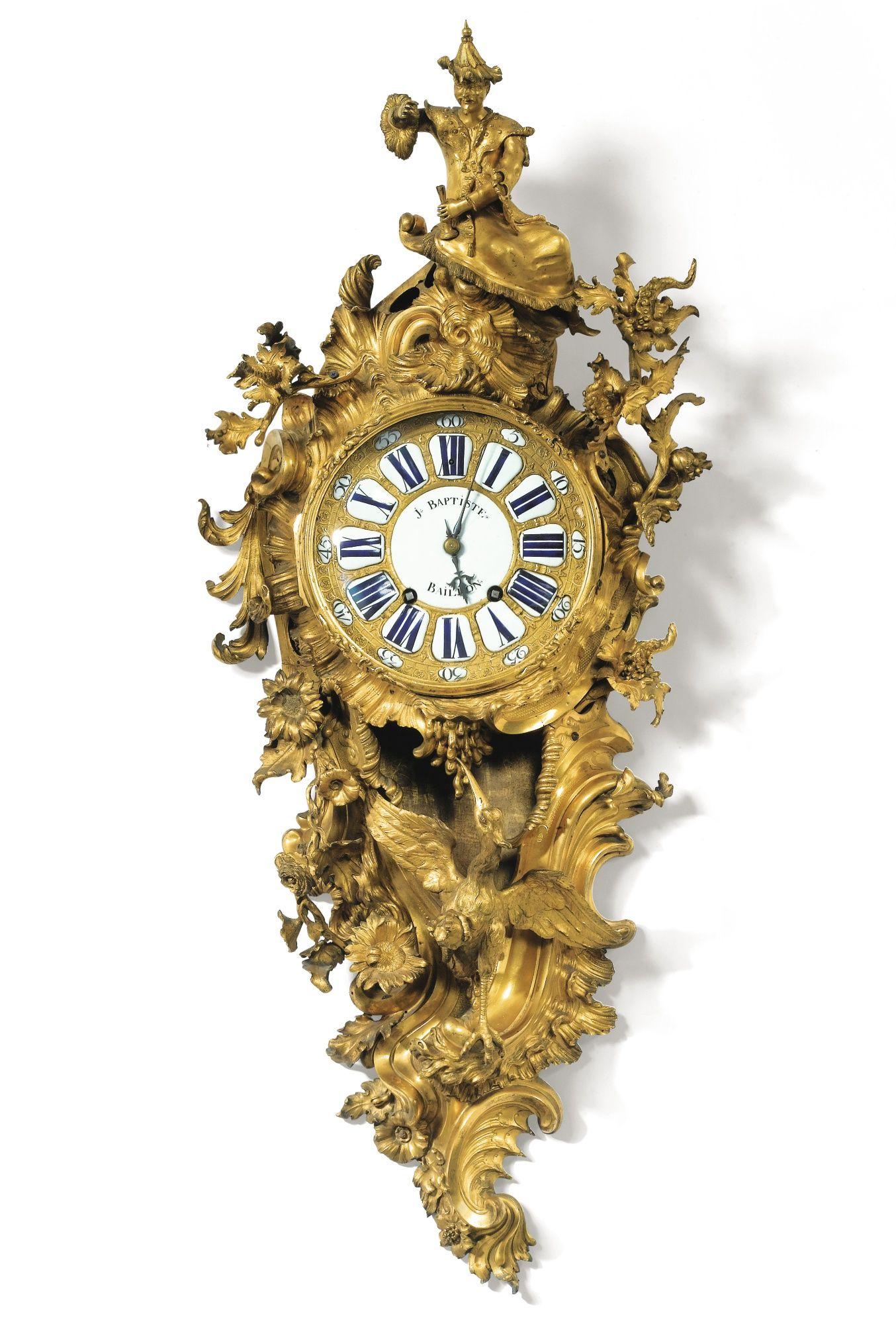 c174045 An impressive giltbronze cartel clock, Louis XV